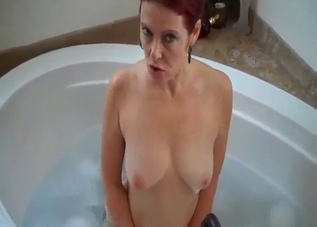 Redhead mom shows off her massive boobs