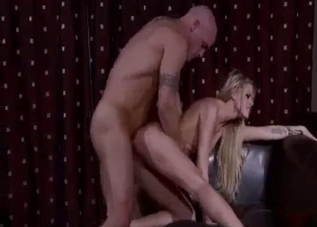 Slender blonde impaled in doggy style pose