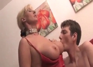 Busty stepmother jerks her horny son