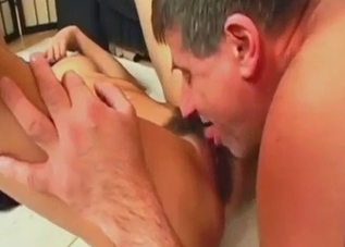 Daughter jerks and sucks her daddy's balls