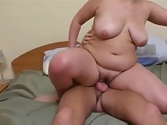 Big-ass mother rides a huge boner