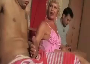 Two hard boners sucked by sexy mommy