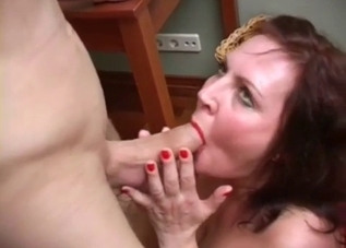 Fat mother blows her young son