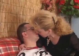 Slutty mother is sucking her younger son