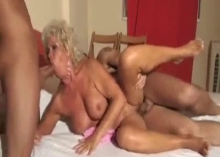 Mom is sucking two loaded hard sausages