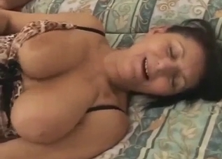 Busty hottie gives a good blowjob in bed