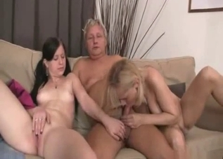 Blonde and brunette sucking a huge wiener